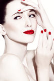 Brunette with red lipstick Stock Images