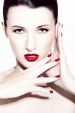 Brunette with red lipstick Royalty Free Stock Image