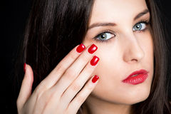 Brunette with red nails Royalty Free Stock Image