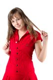 Brunette in red touches hair Royalty Free Stock Photos
