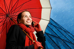 Brunette with red umbrella Royalty Free Stock Images