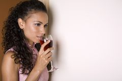 Brunette and red wine Royalty Free Stock Images