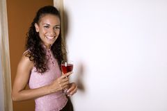 Brunette and red wine Stock Photography
