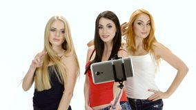 Brunette, redhead and blonde girl pose for a selfie photo stock footage