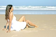 Brunette relaxing at the beach Royalty Free Stock Photography