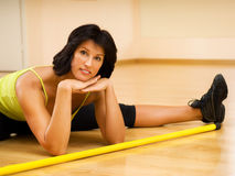 Brunette relaxing after fitness Royalty Free Stock Photos