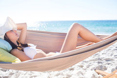 Brunette relaxing in the hammock Royalty Free Stock Photography