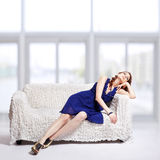 Brunette relaxing on sofa Royalty Free Stock Photo