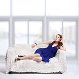 Brunette relaxing on sofa Royalty Free Stock Photography