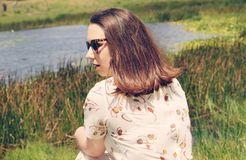 Brunette resting in park on the grass Stock Photography