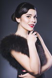 Brunette Retro Woman with red lips make up and wave bang hairstyle Royalty Free Stock Photography