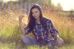 Brunette in  rustic style Stock Images