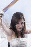 Brunette with samurai sword in the snow, model Royalty Free Stock Photos
