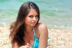 Brunette on sandy beach Royalty Free Stock Image