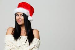 Brunette in Santa Claus hat Stock Photo