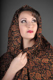 Brunette in a scarf on her head Stock Image