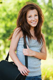 Brunette schoolgirl wearing big bag Royalty Free Stock Photography