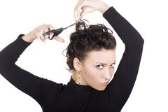 Brunette with scissors Royalty Free Stock Images