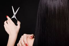 Brunette with scissors Stock Photos
