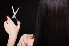 Brunette with scissors Stock Photos