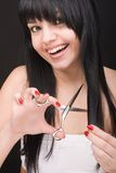 Brunette with scissors of the hairdresser Stock Photo
