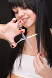 Brunette with scissors of the hairdresser Stock Photos