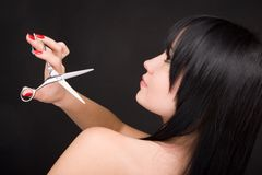 Brunette with scissors of the hairdresser Stock Images