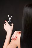 Brunette with scissors of the hairdresser Stock Image