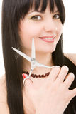 Brunette with scissors of the hairdresser Royalty Free Stock Photos