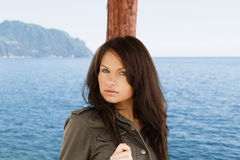 Brunette on the sea Stock Photo