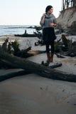 Brunette on sea coast in autumn Stock Images