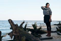 Brunette on sea coast in autumn Royalty Free Stock Photo