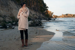 Brunette on the seashore Royalty Free Stock Photos