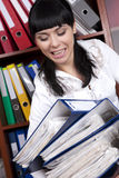 Brunette secretary. Cute  secretary overloaded with files Royalty Free Stock Images