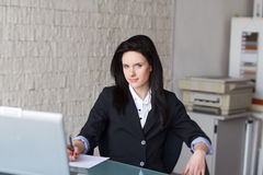 Brunette secretary signing document Royalty Free Stock Photo