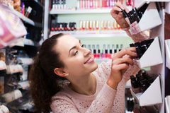 Brunette selecting nail polish Stock Images