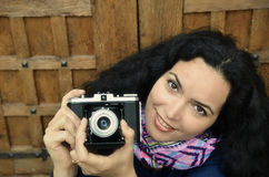 Brunette happy woman with old photo camera Royalty Free Stock Image