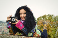 Happy brunette woman with old photo camera Stock Images