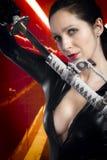 Brunette 'sexy' estilizado do Anime com guardarar uma espada do katana com TW Imagem de Stock Royalty Free