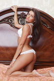 Brunette sexy glamour woman in white bikini Royalty Free Stock Photography