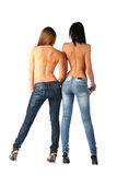 Brunette 'sexy' nas calças de brim foto de stock