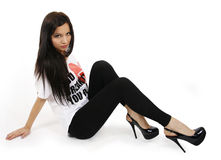 Brunette in sexy shoes sitting on the floor Stock Photo