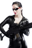 Brunette sexy woman in latex with gun Royalty Free Stock Photography