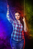 Brunette in shirt and jeans Stock Images