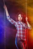 Brunette in shirt and jeans Stock Image