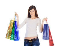 Brunette with shopping bags over white Stock Image