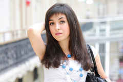Brunette in shopping centre Royalty Free Stock Photos