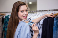 Brunette shopping and holding credit card Stock Photos