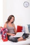 Brunette shopping online Stock Photo