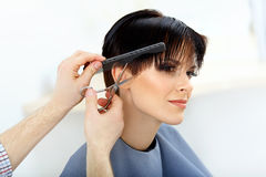 Brunette with Short Hair in Hair Salon. royalty free stock photo